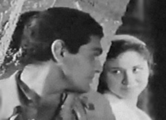 """Faten Hamama - Hamama and Omar Sharif in a scene from the 1957 film Ard el salam (""""Land of Peace"""")."""