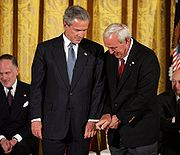 Palmer gives President Bush golf tips before being awarded the Presidential Medal of Freedom