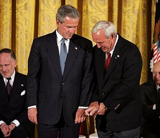 Arnold Palmer - Palmer gives President Bush golf tips before being awarded the Presidential Medal of Freedom, 2004
