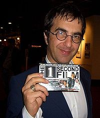 Egoyan holding a producer credit for The 1 Second Film in October 2005