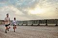 Australian Army Capts. George Minns, left, and Julia Nikolic participate in the Sand to Sand charity run at Multinational Base Tarin Kowt, Uruzgan province, Afghanistan, Aug. 17, 2013 130817-O-MD709-066-AU.jpg