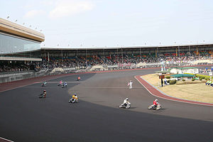 Auto Race (Japanese sport) - Auto Race competitors cross the finish line at Kawaguchi Auto Race Circuit