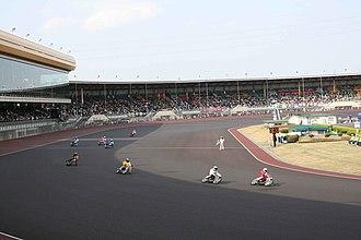 Auto Race (Japanese sport) - Auto Race competitors cross the finish line at Kawaguchi Auto Race Circuit