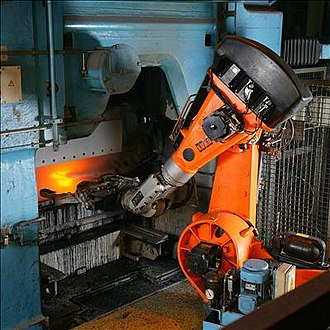 Industrial robot - Articulated industrial robot operating in a foundry.