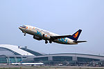 B-2579 - Hainan Airlines - Boeing 737-33A - Blue Flowers Livery - CAN (16356596234).jpg