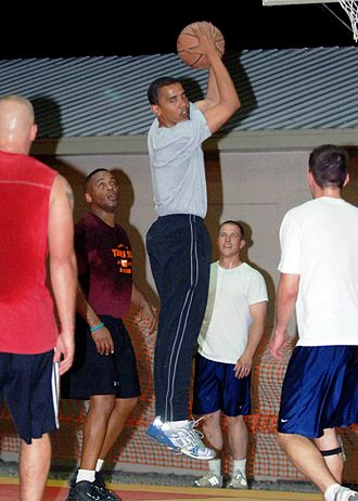 Rebound (sports) - Barack Obama rebounding the ball in a game of basketball with U.S. military personnel in Djibouti