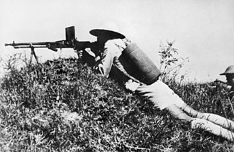 Battle of Changsha (1942) - A Chinese soldier mounts his ZB vz. 26 light machine gun at Changsha, January 1942.