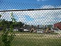 Belmont Park LIRR Station through the fence.JPG