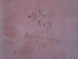 "Berber calendar - Photo taken on 31 December 2007 near Tafraout (Morocco), with the writings aseggas ameggaz (""good year"") in Tifinagh and bonne année 2959 (""good year 2959"") in French. Note the 1-year mistake, as 2959 corresponds to the Gregorian year 2009."