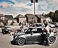 Big Man Small Car (5737682555).jpg