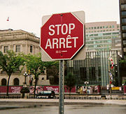 Bilingual (English/French) stop sign on Parliament Hill in Ottawa. An example of bilingualism at the federal government level in Canada.