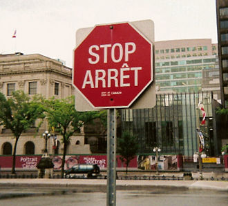 Official bilingualism in Canada - Bilingual (English/French) stop sign on Parliament Hill in Ottawa.