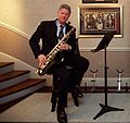 Bill Clinton in the White House Music Room (cropped1).jpg