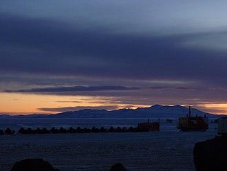 Black Island (Ross Archipelago) - Black Island and Skidoos at Sunset