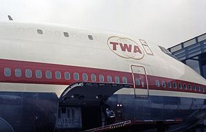 TWA Flight 800 - The close-up view of N93119's front fuselage, showing the 7 plugged windows on the upper deck. These plugs were blown out following the explosion of Flight 800.