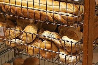 Bread roll - Bread rolls (lower bin) at a bakery