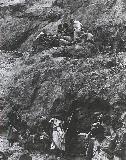 British mercenaries in the mountains of North Yemen helping Royalist rebels set up a heavy machine gun above a hideout cave British Mercenaries in North Yemen Civil War.jpg