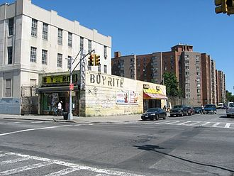 Brownsville, Brooklyn - Local retail; the Riverdale Towers sit in the background