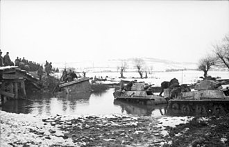 World War II in Yugoslavia - German forces with French-made H39 tanks fording a river.