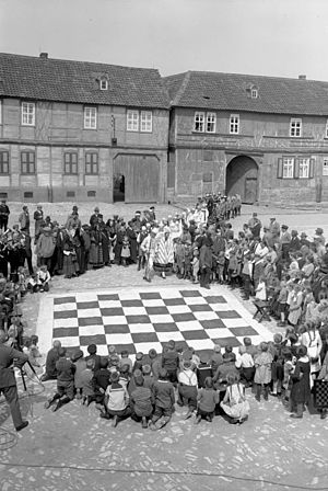 Ströbeck - People in Ströbeck prepare to play a game of human chess, 1932
