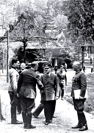 20 July plot - Hitler shaking hands with Bodenschatz, accompanied by Stauffenberg (left) and Keitel (right). Bodenschatz was seriously wounded five days later by Stauffenberg's bomb. Rastenburg, 15 July 1944.