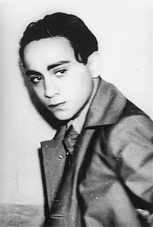 A concerned-looking Grynszpan, wearing an overcoat