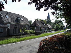 Houses and Jacobus Church in Cabauw