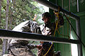 Cadet Breenen Doughty, from Todd Beamer High School, in the Junior Reserve Officers' Training Corps, is hooked up to a safety harness.jpg