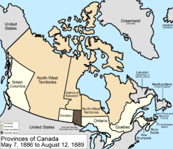 Map of the country of Canada on May 7, 1886, depicting the larger postage stamp sized province of Manitoba along with the provinces of Ontario northern border extended to the 51st parallel north, Prince Edward Island, Quebec (southern portion only), New Brunswick, British Columbia and Nova Scotia, in the colour white. The disputed area between Manitoba and Ontario is coloured black. Provinces are coloured white. The North-West Territories is separate from the slightly smaller District of Keewatin north of Manitoba.  Territories are depicted in the colour pink; additionally now the northern arctic islands are a part of the NWT.  The District of Keewatin now has a geographically shaped border to encompass the eastern borders of the newly formed provisional districts of the NWT.  The area called Newfoundland, Labrador, and Alaska are depicted in bluish grey colour, and are not a part of Canada.