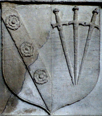 Manor of Clovelly - Arms of Sir William Cary (1437–1471), as seen on the base of the monument in Clovelly Church of his grandson Robert Cary (died 1586), showing Cary impaling Sable, three swords pilewise points in base proper pomels and hilts or (Poulett)
