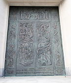 Church front door with bas-relief sculpture