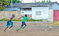 Children playing football Zambia.jpg