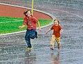 Children running in the rain 2008.jpg