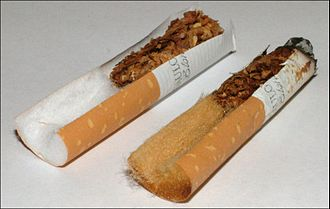 Cigarette filter - Filters in a new and used cigarette. Filters were designed to turn brown with use in order to give the illusion that they are effective at reducing harms.