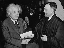 Albert Einstein receiving his certificate of American citizenship from Judge Phillip Forman.