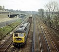 Class 47 Co-Co no. 47140 approaches Leicester from the south with a train of ballast wagons, Nigel Tout, 13.4.75.jpg