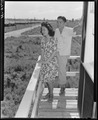 Closing of the Jerome Relocation Center, Denson, Arkansas. Clara Hasegawa and Tad Mijake take a las . . . - NARA - 539628.tif