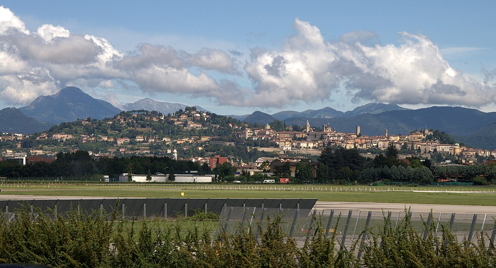 Bergamo Upper Town and Alpi Orobie from the airport Cloudy day in Bergamo, view from Airport parking - panoramio.jpg