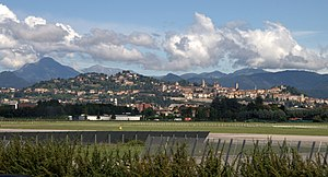 Bergamo - Upper City seen from Bergamo Il Caravaggio International Airport. The Bergamo Alps begin immediately north of the city.