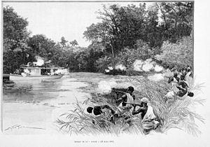 "Second Franco-Dahomean War - Dahomey warriors firing at the gunboat ""Topaze""."