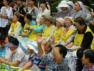 Japan–Korea disputes - Surviving comfort women (in middle row) at a 'Wednesday demonstration' in front of Japanese Embassy in Seoul