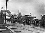 Convoy of repatriated POWs departing after being unloaded from HMS Formidable in October 1945.JPG
