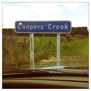Coopers Creek, New Zealand - A sign on the edge of Coopers Creek.