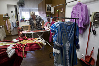Costume design - A woman creating in a costume workshop in Prague theater.