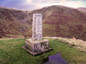 "Moffat Hills - Covenanter Monument to John Hunter above the Devil's Beef Tub --- Inscription on the monument reads ""On the hillside opposite John Hunter Covenanter was shot by Douglas's Dragoons 1685 his grave is in Tweedsmuir Kirkyard"""