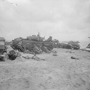 1st Assault Brigade Royal Engineers - Medics are attending to wounded in the shelter of a Churchill AVRE from 5th Assault Regiment, Royal Engineers - Sword Beach, 6 June 1944