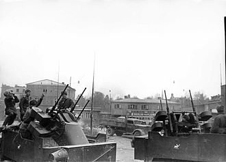 East Pomeranian Offensive - Soviet Red Army troops manning two M17 Multiple Gun Motor Carriage (MGMC) self-propelled anti-aircraft vehicles (half-tracks) in Danzig in March of 1945.