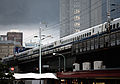 Dark skies over Tokyo bullet train (3899598592).jpg
