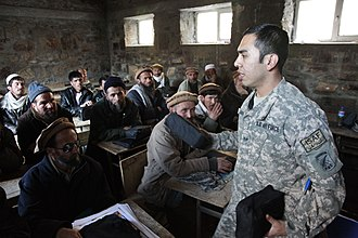 Panjshir Province - U.S. Air Force Staff Sgt. Abraham Jara hands out first aid kits to Afghan locals during a first aid class at a school in the Dara district of Panjshir province.