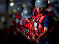Defense.gov News Photo 110225-N-2055M-058 - U.S. Navy sailors man a line in the hangar bay aboard the aircraft carrier USS Carl Vinson CVN 70 during a replenishment in the Arabian Sea on Feb.jpg